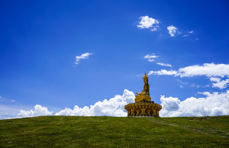 Sichuan, China - Aug 18, 2016. Big Buddha under blue sky in Garze Tibetan, Sichuan, China. Tibetan Buddhism is historically the predominant religion practiced in Garze.