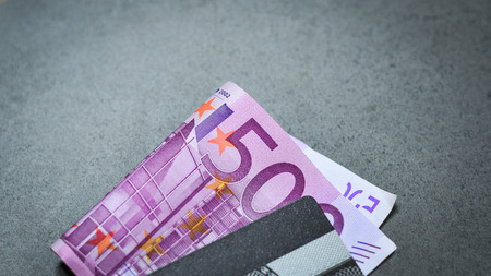 euromoney: Five hundreds (500) Euro banknotes with a credit card, close up.