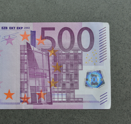 euromoney: Five hundreds (500) Euro banknotes, close up, with gray stone background