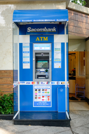 emerging economy: Saigon, Vietnam - Dec 12, 2015. Sacombank ATM machine in Saigon, Vietnam. In 2007, the Saigon GDP was estimated at 14.3 billion dollars, or about 2,180 USD per capita. Editorial