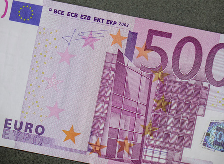 euromoney: Detail of Five hundreds (500) Euro banknote with gray stone background