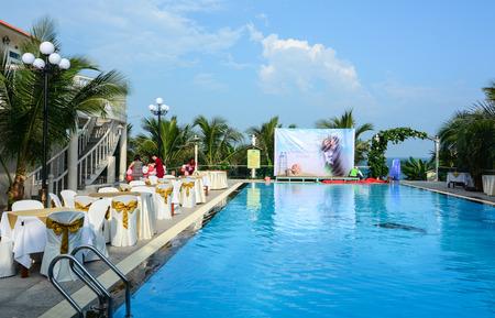 inground: Phan Thiet, Vietnam - Oct 10, 2015. Swimming pool at luxury resort in Phan Thiet, southern Vietnam. Phan Thiet is Vietnam most prominent coastal resort town. Editorial