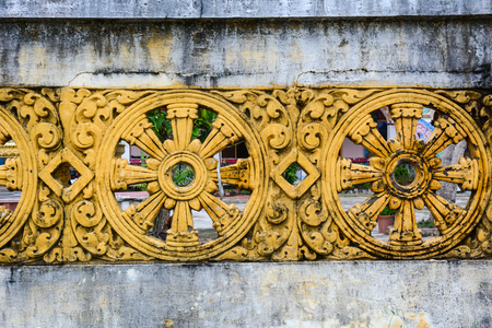casa colonial: Old wall with Buddhist wheel decoration at Khmer temple. Close up.