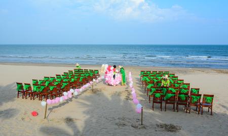 Phan Thiet, Vietnam - Oct 10, 2015. People working for wedding party on beach in Phan Thiet, Vietnam. Phan Thiet is Vietnam most prominent coastal resort town.