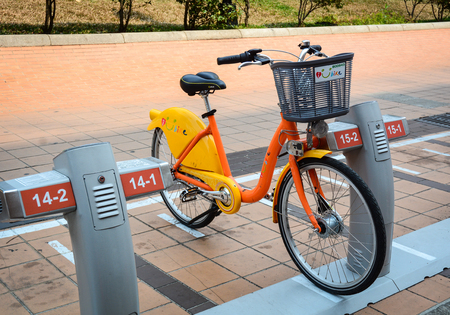 Taichung, Taiwan - Mar 15, 2015. Auto bicycle rental service in Taichung, Taiwan. Taichung has a vibrant, diverse economy that incorporates traditional businesses.