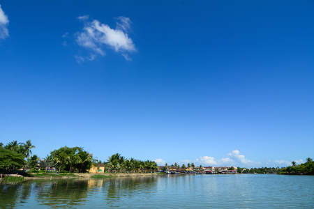 River scenery with cloudscape in Hoi An, Vietnam. Hoi An Town is a well-preserved example of a Southeast Asian trading port dating from the 15th to the 19th century. Stock Photo