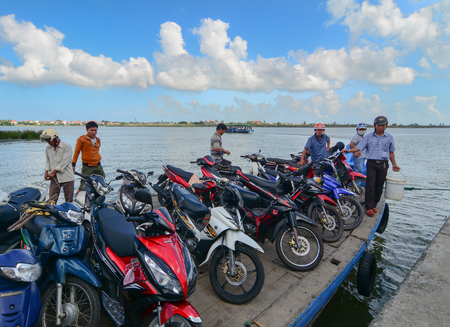 Hoi An, Vietnam - Dec 3, 2015. Wooden ferry carrying motorbikes on river in Hoi An, Vietnam. Ancient and peaceful, Hoi An is one of the most popular destinations in Vietnam. Editorial