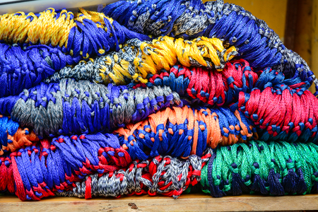 Colorful textile for sale at Asian local market. Close up.