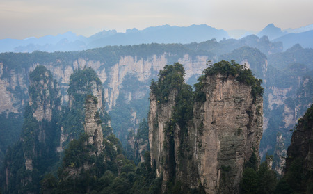 Rock mountains at rainy day in Zhangjiajie National Park in Hunan, China. Zhangjiajie is a unique national forest park located in northern Hunan Province.