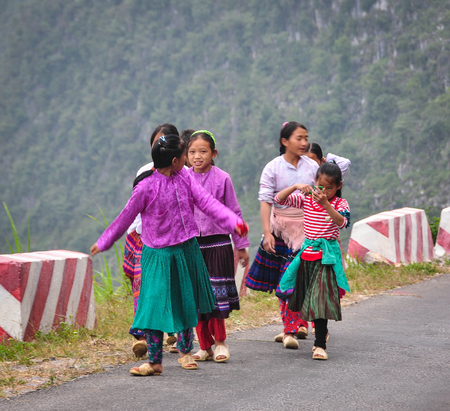 ha giang: Ha Giang, Vietnam - Oct 13, 2014. Hmong women on mountain road in Ha Giang province, Vietnam. Ha Giang shares a 270 km long border with Yunnan province of southern China.