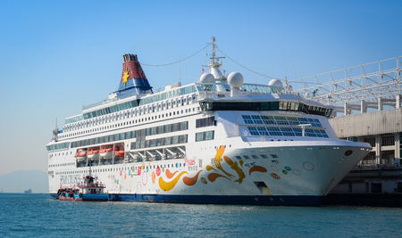 Hong Kong - Dec 30, 2014. Cruise liner at Kowloon pier in Hong Kong, China. Hong Kong is one of the most popular destinations in the world with 40 millions visitors per year.