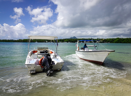 Flacq, Mauritius - Jan 12, 2017. Speedboats docking on the beach in Ile Aux Cerfs Island, Flacq, Mauritius. The island is one of the must place to visit and see in Mauritius.