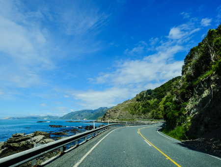 Highway near the blue sea at sunny day in Mackenzie, New Zealand.