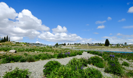 Landscape with farmland and cloudy sky in Mackenzie, New Zealand.