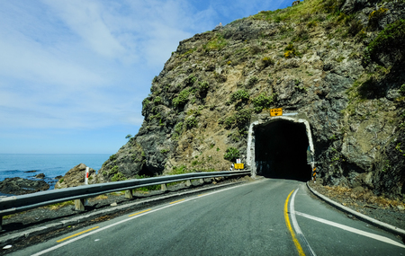 Highway with tunnel at sunny day in Mackenzie, New Zealand.