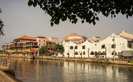 malaysia culture: Melaka, Malaysia - Feb 9, 2014. Chinese traditional houses with canal in Melaka, Malaysia. Malacca has developed over 500 years of trading and cultural exchanges.