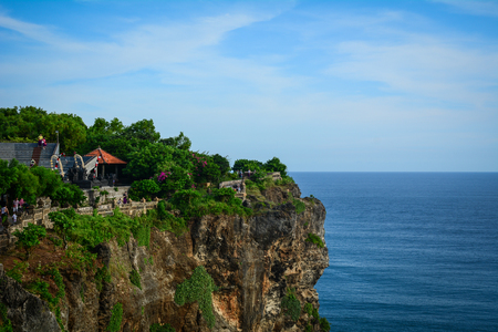 Bali, Indonesia - Apr 22, 2016. View of Pura Uluwatu temple in Bali island, Indonesia. The temple (pura in Balinese) is built at the edge of a 70 meter high cliff or rock projecting into the sea. Editorial