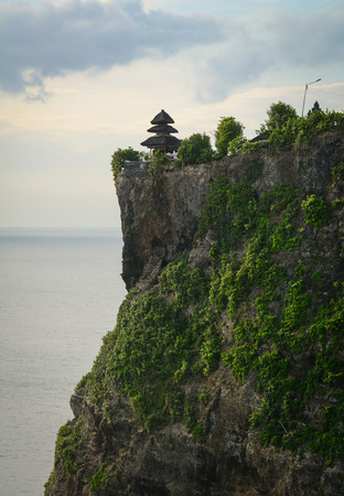 Pura Uluwatu temple in Bali island, Indonesia. The temple (pura in Balinese) is built at the edge of a 70 meter high cliff or rock projecting into the sea.