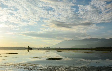 Reflection of Dal Lake at sunset in Srinagar, India. Srinagar, the summer capital of Jammu & Kashmir, is as beautiful as it is politically unstable. Stock Photo