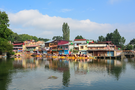 Srinagar, India - Jul 24, 2015. Wooden houses on Dal Lake in Srinagar, India. Srinagar, the summer capital of Jammu & Kashmir, is as beautiful as it is politically unstable.