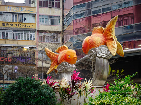 trapped: Hong Kong, China - Mar 29, 2017. Fish statues at gold fish market in Hong Kong, China. Gold fish market in Tung Choi street is famous for tourists. Editorial