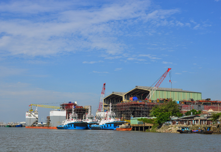Saigon, Vietnam - Mar 25, 2017. Shipyard on the Saigon River in Saigon, Vietnam. The Saigon River is joined 29 kilometres (18 mi) northeast of Ho Chi Minh City.