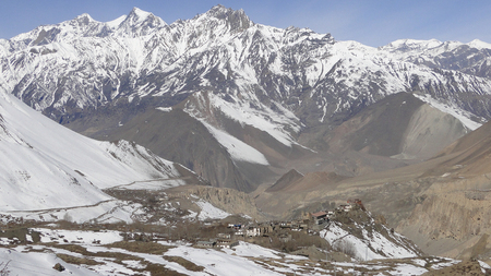 broadly: Winter scene with mountain background at sunny day in Mustang, Nepal. Nepal has five climatic zones, broadly corresponding to the altitudes.