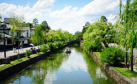 Okayama, Japan - Jun 14, 2015. View of the canal with many trees at Kurashiki Ancient Town in Okayama, Japan. Kurashiki is a historic city located in western Okayama Prefecture.