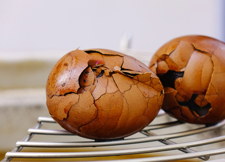 Chinese eggs boiled with tea and spices. Isolated and closed up.