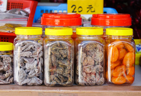 Counter with dried fruit and nuts at a farmers market. Close up. Stock Photo