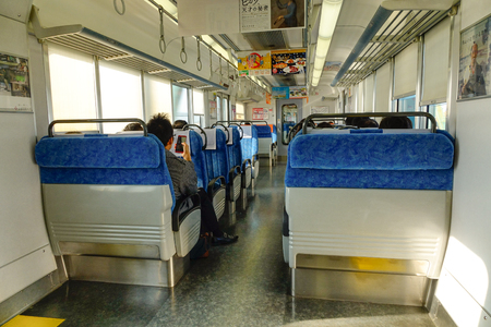 Tokyo, Japan - Dec 25, 2015. Interior of the local train at railway station in Tokyo, Japan. Rail transport services in Japan are provided by more than 100 private companies. Editorial
