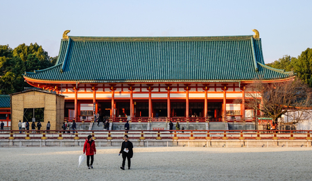 Kyoto, Japan - Dec 25, 2015. People walking at the Main Hall of Heian Shrine, one of the famous shrine in Kyoto, Japan. Its unique with a biggest gate in Japan.