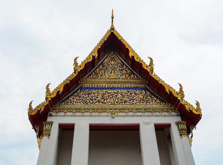 Top of Buddhist temple in Bangkok, Thailand. Buddhist temples in Thailand are characterized by tall golden stupas.