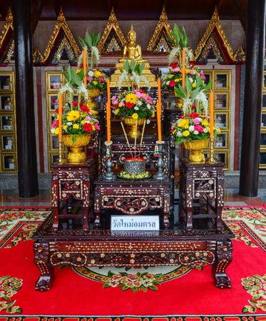 BANGKOK, THAILAND - JUL 30, 2015. Small altar at Wat Intharawihan in Bangkok, Thailand. The temple is known for its enormous 32 meters high standing Buddha image.