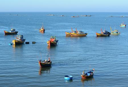 Phan Thiet, Vietnam - Mar 19, 2016. Fishing boats on the sea in Mui Ne town, Phan Thiet, Vietnam. Mui Ne is a coastal fishing town in the Southern Vietnam. Editorial