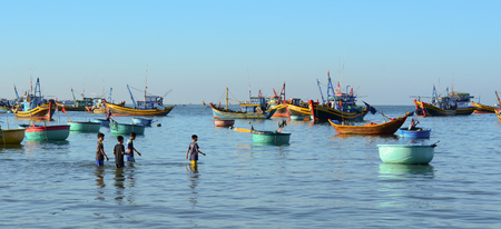 Phan Thiet, Vietnam - Mar 19, 2016. People working at fishing village in Mui Ne town, Phan Thiet, Vietnam. Mui Ne is a coastal fishing town in the Southern Vietnam.