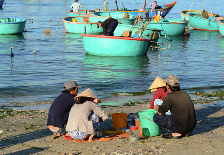 Phan Thiet, Vietnam - Mar 19, 2016. People sell fish at local pier in Mui Ne town, Phan Thiet, Vietnam. Mui Ne is a coastal fishing town in the Southern Vietnam.