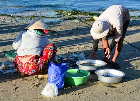 forage fish: Phan Thiet, Vietnam - Mar 19, 2016. People working at the fishing market in Mui Ne town, Phan Thiet, Vietnam. Mui Ne is a coastal fishing town in the Southern Vietnam. Editorial