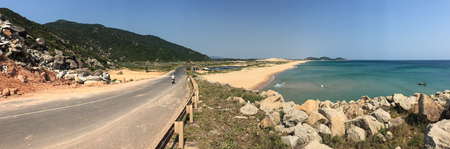 View of the highway from Nha Trang to Dalat near the tropical sea in Vietnam. The total length of the Viet Nam road system is about 222,179 km. Banco de Imagens - 76561269