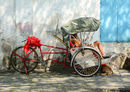 Georgetown, Malaysia - Mar 10, 2016. Rickshaw on the main streets in historical Georgetown, Malaysia. One of the oldest cities in Malaysia, George Town was inscribed as a UNESCO in 2008.