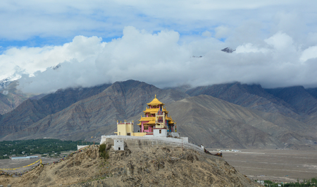 Mountain scenery with a Tibetan Buddhist Monastery on the hill in Leh, Ladakh, India. Ladakh is one of the most sparsely populated regions in Jammu and Kashmir.