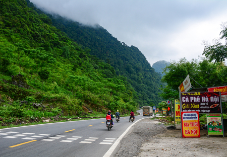 Sapa, Vietnam - May 25, 2016. Motorbikes run on mountain road in Sapa, Vietnam. Sapa is a frontier township and capital of Sa Pa District in north-west Vietnam.
