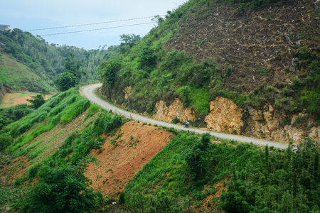 ha giang: Mountain road in Ha Giang, Northern Vietnam. Ha Giang Province borders China with a length of over 270 kilometres (170 mi).