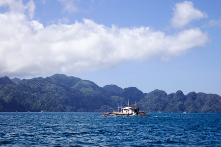 A wooden boat running on the sea in Coron Island, Philippines. Coron has been described as one of the best spots in the World for Wreck diving.