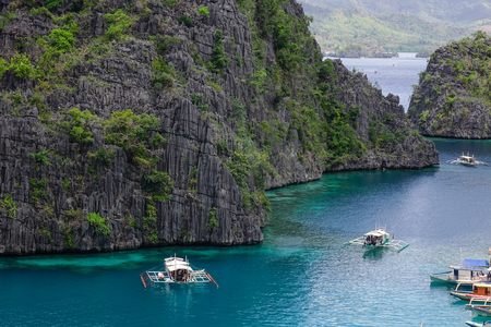 Coron, Philippines - Apr 9, 2017. Tourist boats on the Kayangan Lake in Coron Island, Philippines. Coron has been described as one of the best spots in the World for Wreck diving.