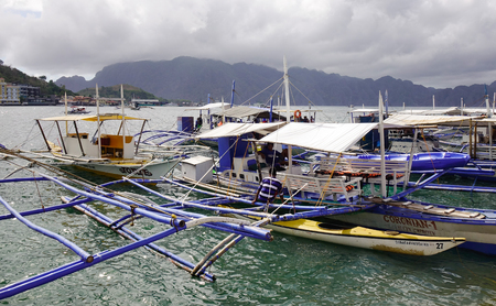 Coron, Philippines - Apr 9, 2017. Wooden boats docking at the tourist jetty in Coron Island, Philippines. Coron has been described as one of the best spots in the World for Wreck diving.