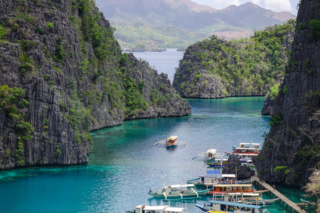 Coron, Philippines - Apr 9, 2017. Tourist jetty on the Kayangan Lake at sunny day in Coron Island, Philippines. Coron has been described as one of the best spots in the World for Wreck diving. Editorial