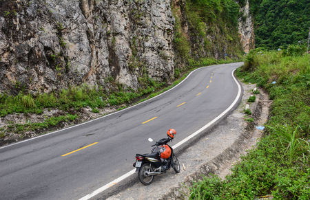 Sapa, Vietnam - May 25, 2016. A motorbike parking on mountain road in Sapa, Vietnam. Sapa is a frontier township and capital of Sa Pa District in north-west Vietnam. Editorial