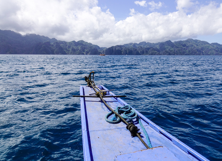 Part of a wooden boat with an anchor on the sea in Coron Island, Philippines. Coron has been described as one of the best spots in the World for Wreck diving.