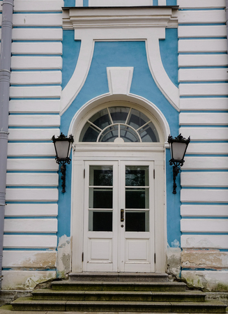 White door at an old palace in Saint Petersburg, Russia.